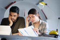 Man and Woman Worried For Taxes And Family Budget Stock Image