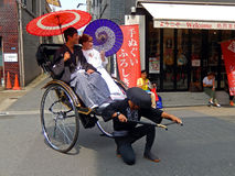 Young couple in rickshaw, Tokyo, Japan Stock Images