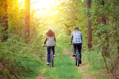 Young couple ride bicycles Royalty Free Stock Images