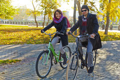 Young couple riding a bicycle Royalty Free Stock Photos