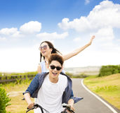 Young couple riding bicycle in the park stock photos