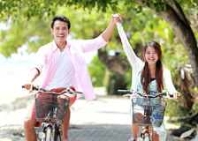 Young couple riding bicycle together Royalty Free Stock Photo