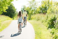 Young couple riding bicycles in summer stock photography