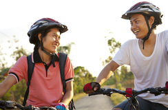 Young couple riding bike Stock Image