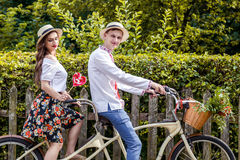 Young couple riding a bike tandem in the park Royalty Free Stock Photos