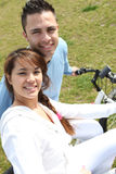 Young couple riding bikes Stock Images