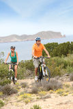 Young couple riding bikes in islands Stock Photos