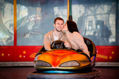 Young couple riding car in amusement park Stock Image