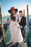 A  young couple riding a gondola  in Venice. Italy. Wedding. A  young couple riding a gondola  in Venice. Italy Stock Images