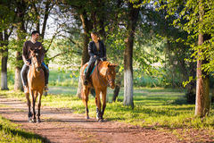 Young couple  riding a horse Royalty Free Stock Photos