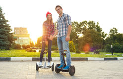 Young couple riding hoverboard Royalty Free Stock Image