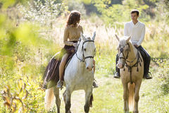 Young couple riding Stock Photos