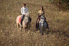 Young couple riding Royalty Free Stock Images