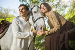 Young couple riding Royalty Free Stock Image