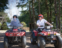 Young couple riding a quad Stock Photos