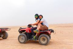 Young couple riding sand ATV Royalty Free Stock Photos