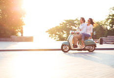 Young couple riding a scooter Royalty Free Stock Photography