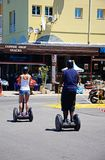 Couple riding segways, Vilamoura. Young couple riding on segways in the town, Vilamoura, Algarve, Portugal, Europe stock photo