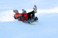 Young couple riding on a sled holding each other. Winter fun. The action takes place on the outskirts of the city of Monino. Residents of the town come with stock photos