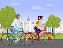 Young couple riding a sport bikes on a park road on the old city background. People bicycle Vector illustration. Royalty Free Stock Photography