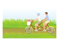 Young couple riding tandem royalty free stock photos