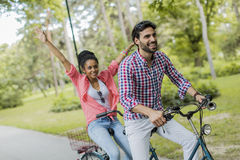 Young couple riding on the tandem bicycle Royalty Free Stock Photo
