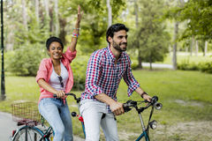 Young couple riding on the tandem bicycle Royalty Free Stock Photos