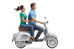Young couple riding on a vintage motorbike stock photos