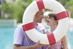 Young couple with ring-buoy Stock Photography