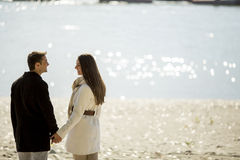 Young couple by the river royalty free stock photos