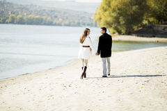Young couple by the river stock photography
