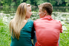 Young couple at riverside Royalty Free Stock Images
