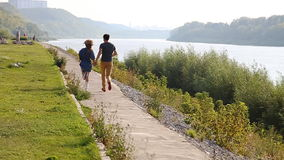 Young couple on the riverside stock footage