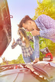 Young couple on the road has problems with their car Stock Image