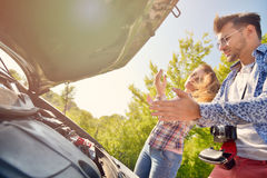 Young couple on the road has problems with their car Stock Photo