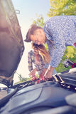 Young couple on the road has problems with their car Royalty Free Stock Photo