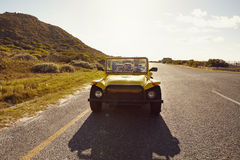 Young couple on road trip in beach buggy Royalty Free Stock Photos
