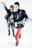 Young couple with rocker outfit Royalty Free Stock Image