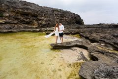 Young couple among the rocks royalty free stock photos