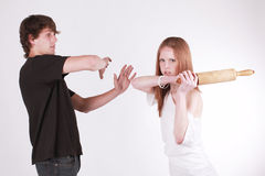 Young couple with rolling pin Stock Photo