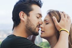 Young couple romancing. Close-up of a young couple romancing Stock Image