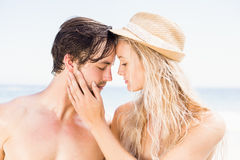 Young couple romancing on the beach Stock Photo