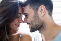 Young couple romancing in bedroom. At home Stock Photo