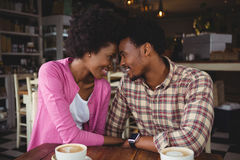 Young couple romancing while having coffee Royalty Free Stock Images