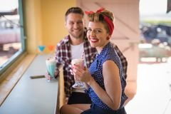 Couple romancing in restaurant. Young couple romancing in restaurant Royalty Free Stock Photo