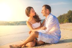 Young couple in romantic mood enjoying on the beach. stock photos