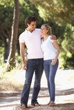 Young Couple On Romantic Walk In Countryside Stock Image