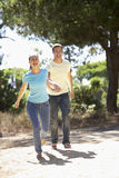 Young Couple On Romantic Walk In Countryside Royalty Free Stock Image