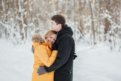 Young couple on romantic  winter walk in a park Royalty Free Stock Photography