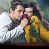Young couple with rose. Outdoors Royalty Free Stock Images